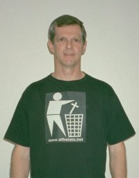 Darwin Bedford wearing a T-shirt depicting the international symbol for a wastes container with a religious cross in place of the wastes.
